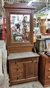 Walnut/marble dresser in Fort Campbell, Kentucky