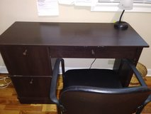Office desk with lamp, chair and much space in Kankakee, Illinois