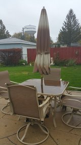 Patio table and 4 chairs and umbrella in St. Charles, Illinois