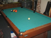 Mizerak brand pool table with 7 cues with pro cues in Temecula, California