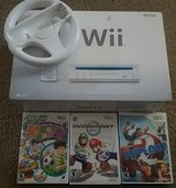 wii, 3 games, mario kart racing wheel, 1 xtra wiimote in Fort Bliss, Texas