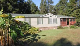3br 2ba 2500sqft modular home with 2.13 acres, stocked pond and large barn/ garage in Hinesville, Georgia