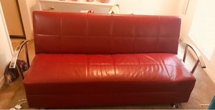Red leather Futon with silver frame in Kansas City, Missouri