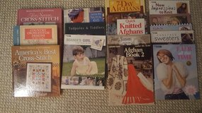 Various knitting and cross stitch books in Oswego, Illinois