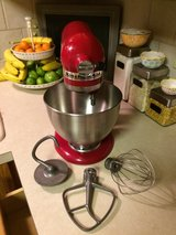 red kitchen aid mixer with attachments in Morris, Illinois
