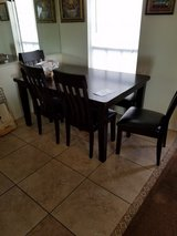 Dining room table by Ashley in Pearland, Texas