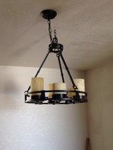 Spanish style chandelier with alabaster sconces in 29 Palms, California