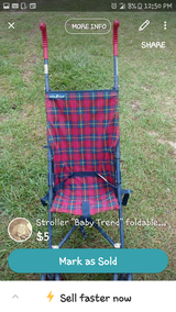 """Stroller """"Baby Trend"""" foldable blue and red plaid in Warner Robins, Georgia"""