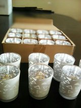 19 votive holders total all are never used i have 12 scented candles (new) in Joliet, Illinois