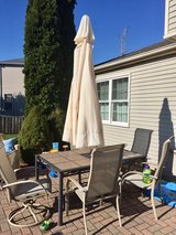 outdoor table, 6 chairs and umbrella in Joliet, Illinois