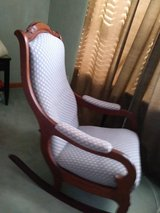 Beautiful upholstered wooden rocking chair with carved wood detailing in Beaufort, South Carolina