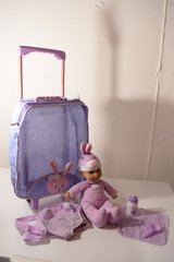 Baby doll with rolling suitcase, doll carrier and accessories in Elgin, Illinois