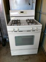Whirlpool Refrigerator with Ice maker  21 Cu Ft. + Kenmore stove With manuals beige color in Joliet, Illinois