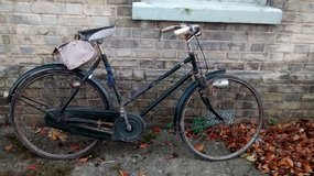Vintage Adult bike with Sturmey Archer gears and pannier bag in Lakenheath, UK