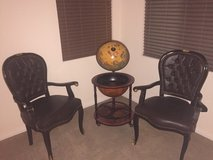 two leather chairs with globe replica in Las Vegas, Nevada