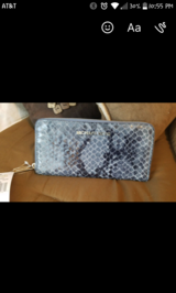 Michael Kors snake print wallet in Spring, Texas