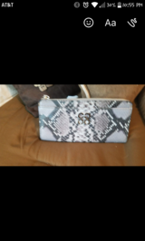 Coach snake print wallet in Spring, Texas