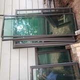 Used storm windows of various sizes in The Woodlands, Texas