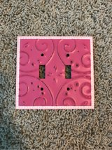 Pink light switch in Kingwood, Texas