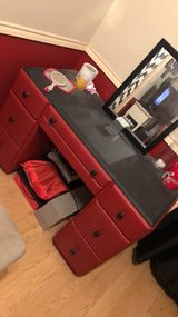 Black and red vanity in Livingston, Texas