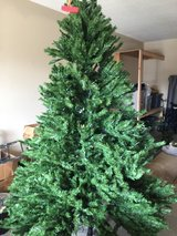 Pre-lit 7 foot Christmas tree in good condition in Warner Robins, Georgia