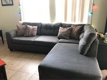 large couch with chaise lounge in Honolulu, Hawaii