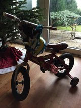 """Boys 12"""" Cars bicycle with training wheels and helmet. in Ramstein, Germany"""