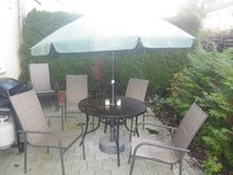 Patio set with Umbrella and eight chairs in Ramstein, Germany