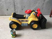 Riding toy tractor in Okinawa, Japan