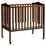 Cherry Color Portable Mini Crib in Hill AFB, UT