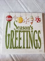 Christmas season's greeting canvas decoration in Plainfield, Illinois