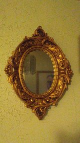 Antique gold florentine style mirror. in Yucca Valley, California