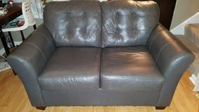 grey leather love seat in Naperville, Illinois