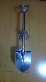 Universal Stainless Steel Spare Tire Shovel with lockable holder in Okinawa, Japan