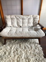 Cream and wooden couch in Okinawa, Japan