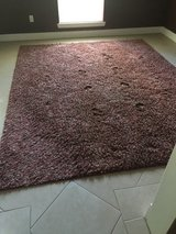 Large rug (red) in Spring, Texas