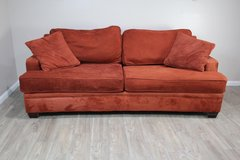 Burnt Orange Sofa in CyFair, Texas