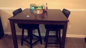 dinner table with two high chairs in Fort Rucker, Alabama