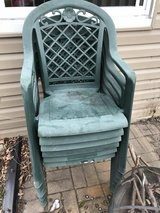 6 green plastic patio chairs in Chicago, Illinois
