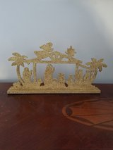Gold glitter nativity table decoration in New Lenox, Illinois