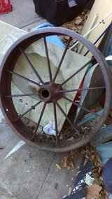 Set of 2 antique wagon wheels in Lawton, Oklahoma
