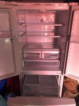 WLG refrigerator with built in ice maker in freezer section. French Doors. Works great. in Camp Pendleton, California