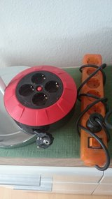Lot of extension cords / US2EU adapters / timer in Ramstein, Germany