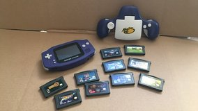 Nintendo GAMEBOY ADVANCE AGB-001 Indigo w/ MAD CATZ Light Grip & 10 games in Chicago, Illinois