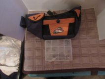 Fishing belt and box with a few extras in Oswego, Illinois