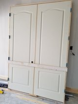 "DOUBLE 2'-8"" X 8'-0"" PREHUNG INTERIOR SOLID CORE DOOR SET WITH CASING in Kingwood, Texas"