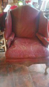 Antique burgundy leather chair in Kingwood, Texas