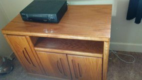 Tv stand with kids vhs tapes and vcr player in 29 Palms, California