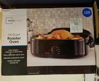 NEW JOB Mainstays 20-pound Turkey Roaster with High-Dome Lid, 14-Quart, Black, in Kingwood, Texas