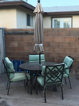 Glass Table with Umbrella and 4 Chairs in Phoenix, Arizona